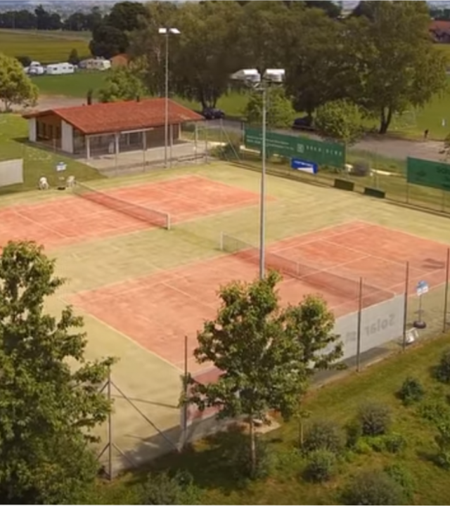 Aerial view of Tennis Club Ins' two clay courts