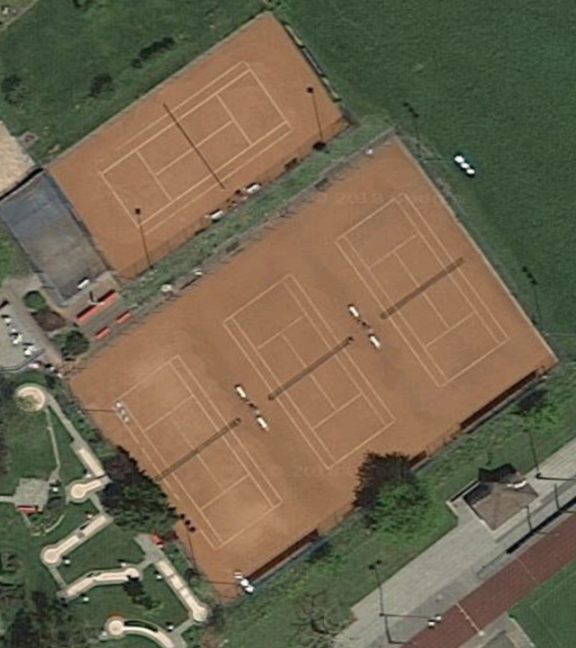 Aerial view of four of Tennis Club Altstätten's six clay courts